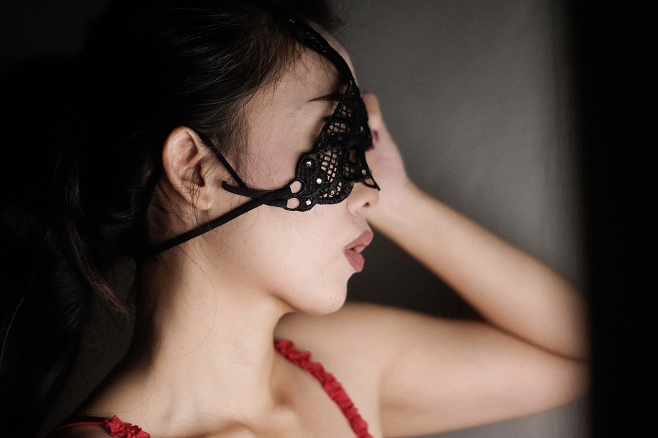 Cam girl wearing a mask.